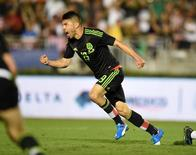 Oct 10, 2015; Pasadena, CA, USA; Mexico forward Oribe Peralta (19) celebrates after scoring a goal in overtime against the United States in CONCACAF Cup match at Rose Bowl. Mandatory Credit: Kirby Lee-USA TODAY Sports