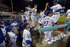 Oct 10, 2015; Los Angeles, CA, USA; Los Angeles Dodgers first baseman Adrian Gonzalez (23) is congratulated for scoring during the seventh inning in game two of the NLDS against the New York Mets at Dodger Stadium. Mandatory Credit: Jayne Kamin-Oncea-USA TODAY Sports
