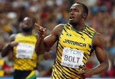 Usain Bolt of Jamaica reacts after winning the men's 200 metres final during the 15th IAAF World Championships at the National Stadium in Beijing, China, August 27, 2015.      REUTERS/David Gray