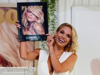 Dani Mathers, 28, the 2015 Playmate of the Year, holds a plaque with the cover of the Playboy June 2015 issue at the Playboy Mansion in Los Angeles, California in this file photo taken May 14, 2015.    REUTERS/Kevork Djansezian/Files