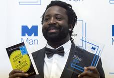 """Marlon James, author of """"A Brief History of Severn Killings"""", poses for photographers after winning the Man Booker Prize for Fiction 2015 in London, Britain October 13, 2015. REUTERS/Neil Hall"""