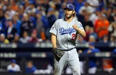 Los Angeles Dodgers starting pitcher Clayton Kershaw (22) reacts after the seventh inning against the New York Mets in game four of the NLDS at Citi Field.  Brad Penner-USA TODAY Sports