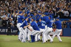 Oct 14, 2015; Toronto, Ontario, CAN; Toronto Blue Jays players celebrate on the field after defeating the Texas Rangers in game five of the ALDS at Rogers Centre. Mandatory Credit: Dan Hamilton-USA TODAY Sports