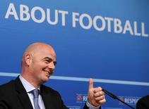UEFA General Secretary Gianni Infantino gestures after a news conference on behalf of their suspended president Michel Platini, following a meeting of UEFA's executive committee at the UEFA headquarters in Nyon, Switzerland, October 15, 2015.  REUTERS/Denis Balibouse