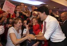 Liberal leader Justin Trudeau greets supporters during a campaign rally in Saint John, New Brunswick, October 17, 2015. Canadians will go to the polls in a federal election on October 19. REUTERS/Chris Wattie