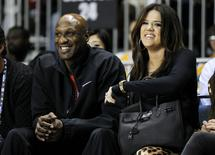 Los Angeles Lakers' Lamar Odom and his wife television personality Khloe Kardashian sit courtside as they attend the 2011 BBVA All-Star Celebrity basketball game as a part of the NBA All-Star basketball weekend in Los Angeles, February 18, 2011. REUTERS/Danny Moloshok