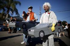 """People portraying characters from the film """"Back to the Future Part II"""" stand outside the Burger King featured in the movie, in Los Angeles, California, October 21, 2015. REUTERS/Lucy Nicholson"""