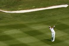 Lu Wei-chih of Taiwan hits on the ninth fairway during the first round of the World Cup golf tournament in Dongguan November 26, 2009.   REUTERS/Bobby Yip