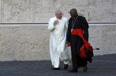 Pope Francis chats with Cardinal Philippe Nakellentuba Ouedraogo (R) as he arrives to lead the synod on the family in the Synod hall at the Vatican, October 23, 2015.REUTERS/Alessandro Bianchi