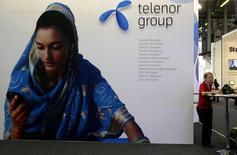Стенд Telenor Group на конференции GSMA Mobile World в Барселоне. 18 февраля 2009 года. Норвежский оператор сотовой связи Telenor сообщил в среду, что базовая прибыль за третий квартал превысила ожидания, однако компания понизила прогноз годовой выручки и рентабельности из-за провала сделки слияния в Дании. REUTERS/Gustau Nacarino