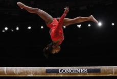 Simone Biles of the U.S competes on the beam during the women's all-round final at the World Gymnastics Championships at the Hydro Arena in Glasgow, Scotland, October 29, 2015.   REUTERS/Phil Noble