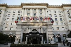 Flags fly over the entrance of the Fairmont hotel, where U.S. President Barack Obama stayed, in San Francisco February 14, 2015.   REUTERS/Kevin Lamarque