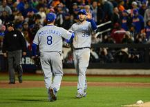 Kansas City Royals first baseman Eric Hosmer (35) celebrates with third baseman Mike Moustakas (8) after defeating the New York Mets in game four of the World Series at Citi Field.  Jeff Curry-USA TODAY Sports