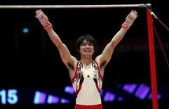 Japan's Kohei Uchimura reacts after his horizontal bar routine during the men's apparatus final at the World Gymnastics Championships at the Hydro arena in Glasgow, Scotland, November 1, 2015. REUTERS/Russell Cheyne