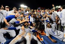 Nov 1, 2015; New York City, NY, USA; Kansas City Royals players pose for a team photo after defeating the New York Mets in game five of the World Series at Citi Field. The Royals win the World Series four games to one. Mandatory Credit: Jeff Curry-USA TODAY Sports