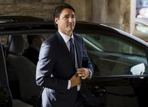 """Canada's Prime Minister designate Justin Trudeau arrives at a funeral for Former Canadian ambassador Ken Taylor, in Toronto, October 27, 2015. Former Canadian ambassador Ken Taylor, whose role in rescuing U.S. diplomats in a covert operation in 1979 during the Iran hostage crisis was featured in the movie """"Argo"""", died on Thursday, his son told CBC television. He was 81. REUTERS/Mark Blinch  - RTX1TIDP"""