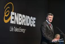 Al Monaco, President and CEO, Enbridge, stands when introduced during the Enbridge Income Fund annual general meeting for shareholders in Toronto May 6, 2015.  REUTERS/Peter Power -