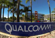 A Qualcomm sign is pictured in front of one of its many buildings in San Diego, California in this November 5, 2014 file photo.  REUTERS/Mike Blake/Files BUSINESS