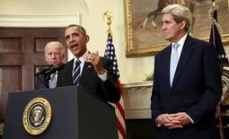 U.S. President Barack Obama, flanked by Vice President Joe Biden (L) and Secretary of State John Kerry (R), speaks about the Keystone XL oil pipeline from the White House in  Washington November 6, 2015.  REUTERS/Kevin Lamarque