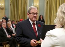 Canada's new Agriculture and Agri-Foods Minister Lawrence MacAulay (L) is sworn-in during a ceremony at Rideau Hall in Ottawa November 4, 2015. REUTERS/Chris Wattie