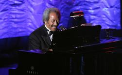 File photo of inductee Allen Toussaint performing during the Songwriters Hall of Fame awards in New York June 16, 2011. REUTERS/Lucas Jackson