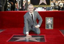 Actor Daniel Radcliffe poses during a ceremony honoring him with a star on the Hollywood Walk of Fame in Hollywood, California November 12, 2015. REUTERS/Danny Moloshok