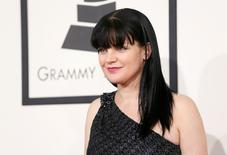 Actress Pauley Perrette arrives at the 56th annual Grammy Awards in Los Angeles, California January 26, 2014.     REUTERS/Danny Moloshok