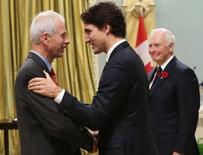 Prime Minister Justin Trudeau congrats Minister of Foreign Affairs Stephane Dion during a swearing-in ceremony at Rideau Hall in Ottawa November 4, 2015. REUTERS/Chris Wattie