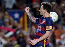 Lionel Messi comemorando gol durante partida contra o Levante, pela Liga Espanhola.   20/09/2015   REUTERS/Susana Vera
