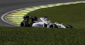 Williams Formula One driver Felipe Massa of Brazil powers his car during the third free practice of the Brazilian F1 Grand Prix in Sao Paulo, Brazil, November 14, 2015. REUTERS/Nacho Doce