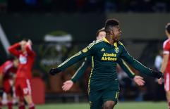 Nov 22, 2015; Portland, OR, USA; Portland Timbers midfielder/forward Dairon Asprilla (middle) celebrates after scoring against FC Dallas in the second half of leg one of the Western Conference championship at Providence Park. The Timbers won 3-1. Mandatory Credit: Godofredo Vasquez-USA TODAY Sports