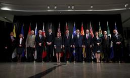 Canada's Prime Minister Justin Trudeau (6th R) poses with provincial and territorial premiers during the First Ministers' meeting in Ottawa, Canada November 23, 2015. Also pictured are L-R Nunavut Premier Peter Taptuna, Alberta Premier Rachel Notley, Prince Edward Island Wade MacLauchlan, Manitoba Premier Greg Selinger, Nova Scotia Premier Stephen McNeil, Ontario Premier Kathleen Wynne, Quebec Premier Philippe Couillard, New Brunswick Premier Brian Gallant, British Columbia Premier Christy Clark, Saskatchewan Premier Brad Wall and Yukon Premier Darrell Pasloski. REUTERS/Chris Wattie