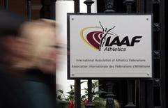 A woman walks past the IAAF (The International Association of Athletics Federations) headquarters in Monaco November 4, 2015.   REUTERS/Eric Gaillard
