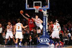 Nov 27, 2015; New York, NY, USA; Miami Heat guard Gerald Green (14) puts a shot over New York Knicks forward Kristaps Porzingis (6) during the third quarter at Madison Square Garden. Miami Heat won 97-78. Mandatory Credit: Anthony Gruppuso-USA TODAY Sports