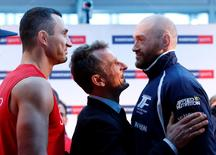 Boxing - Wladimir Klitschko & Tyson Fury Weigh-In - Karstadt Sports Essen, Germany - 27/11/15 Wladimir Klitschko and Tyson Fury go head to head during the Weigh-In Action Images via Reuters / Lee Smith Livepic