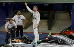 Mercedes Formula One driver Nico Rosberg of Germany celebrates after winning the Abu Dhabi F1 Grand Prix at the Yas Marina circuit in Abu Dhabi November 29, 2015. REUTERS/Hamad I Mohammed