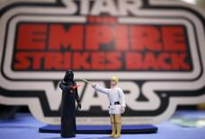 Vintage action figures of Star Wars characters Darth Vader (L) and Luke Skywalker stand on a table ahead of an auction of Star Wars and film related toys at the Vectis auction house in Stockton-on-Tees,  Britain November 23, 2015. REUTERS/Phil Noble