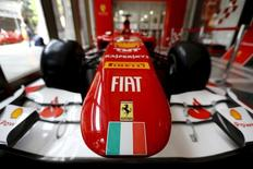 Ferrari and Fiat logos and a Italian flag are pictured on a replica of a Ferrari Formula One car in Santiago city, Chile, October 20, 2015.  REUTERS/Ivan Alvarado