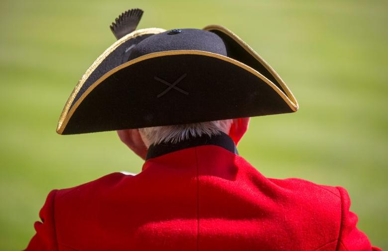 A Chelsea Pensioner views the Founder's Day Parade at the Royal Hospital Chelsea in London, Britain June 4, 2015. REUTERS/Neil Hall