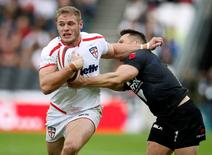 England's Tom Burgess in action with New Zealand's Lewis Brown Action Images / Andrew Couldridge Livepic