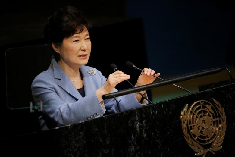South Korea's President Park Geun-hye adjusts the microphones as she addresses attendees during the 70th session of the United Nations General Assembly at the U.N. headquarters in New York, September 28, 2015.   REUTERS/Carlo Allegri