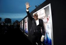 """Cast member Morgan Freeman waves at the premiere of """"Transcendence"""" in Los Angeles, California April 10, 2014. REUTERS/Mario Anzuoni"""
