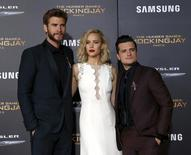 """Cast members Liam Hemsworth (L), Jennifer Lawrence and Josh Hutcherson pose at the premiere of """"The Hunger Games: Mockingjay - Part 2"""" in Los Angeles, California November 16, 2015.   REUTERS/Mario Anzuoni"""