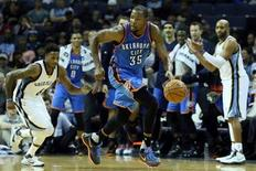 Oklahoma City Thunder forward Kevin Durant (35) drives against the Memphis Grizzlies in the second half at FedExForum. Oklahoma City defeated Memphis 125-88. Mandatory Credit: Nelson Chenault-USA TODAY Sports