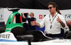Alejandro Agag, Formula E CEO, gestures next to Michela Cerruti's Formula E car in the box during an interview with Reuters ahead of round four of the Formula E championship in Buenos Aires, January 8, 2015.   REUTERS/Marcos Brindicci