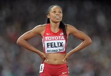 Allyson Felix (USA) celebrates after winning the womens 400m in 49.26 during the IAAF World Championships in Athletics at National Stadium.  Kirby Lee-USA TODAY Sports