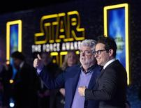 """Star Wars creator George Lucas (L) and director JJ Abrahms pose at the premiere of """"Star Wars: The Force Awakens"""" in Hollywood, California December 14, 2015. REUTERS/Kevork Djansezian"""