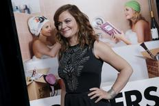 """Actress Amy Poehler poses as she arrives for the world premiere of the film """"Sisters"""" at the Ziegfeld Theater in the Manhattan borough of New York City, December 8, 2015. REUTERS/Mike Segar"""