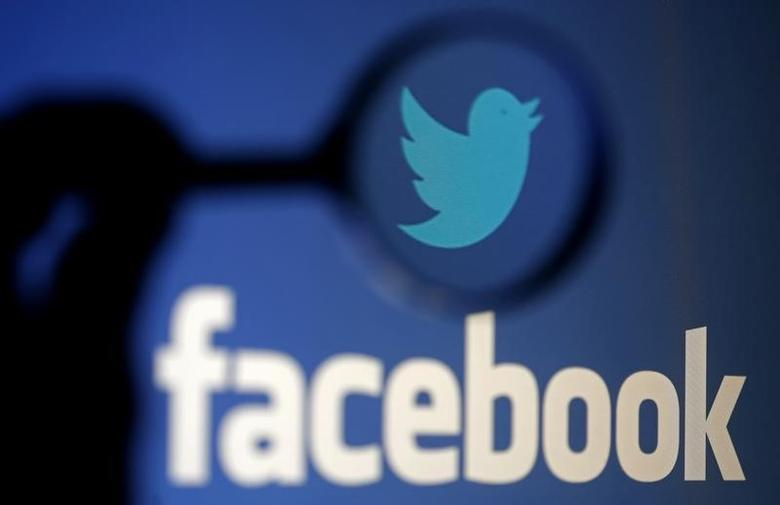 A logo of Twitter is pictured next to the logo of Facebook in this September 23, 2014 illustration photo in Sarajevo.  REUTERS/Dado Ruvic/Files