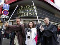 """People dressed in costumes worn by Star Wars characters pose in front of the Grand Rex cinema after viewing """"Star Wars: The Force Awakens"""" in Paris, France, December 16, 2015.   REUTERS/Jacky Naegelen"""